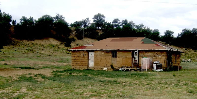 Family home on Navajo Nation (located next to the abandoned uranium mine pictured above). Photo by Lea Rekow, 2010.